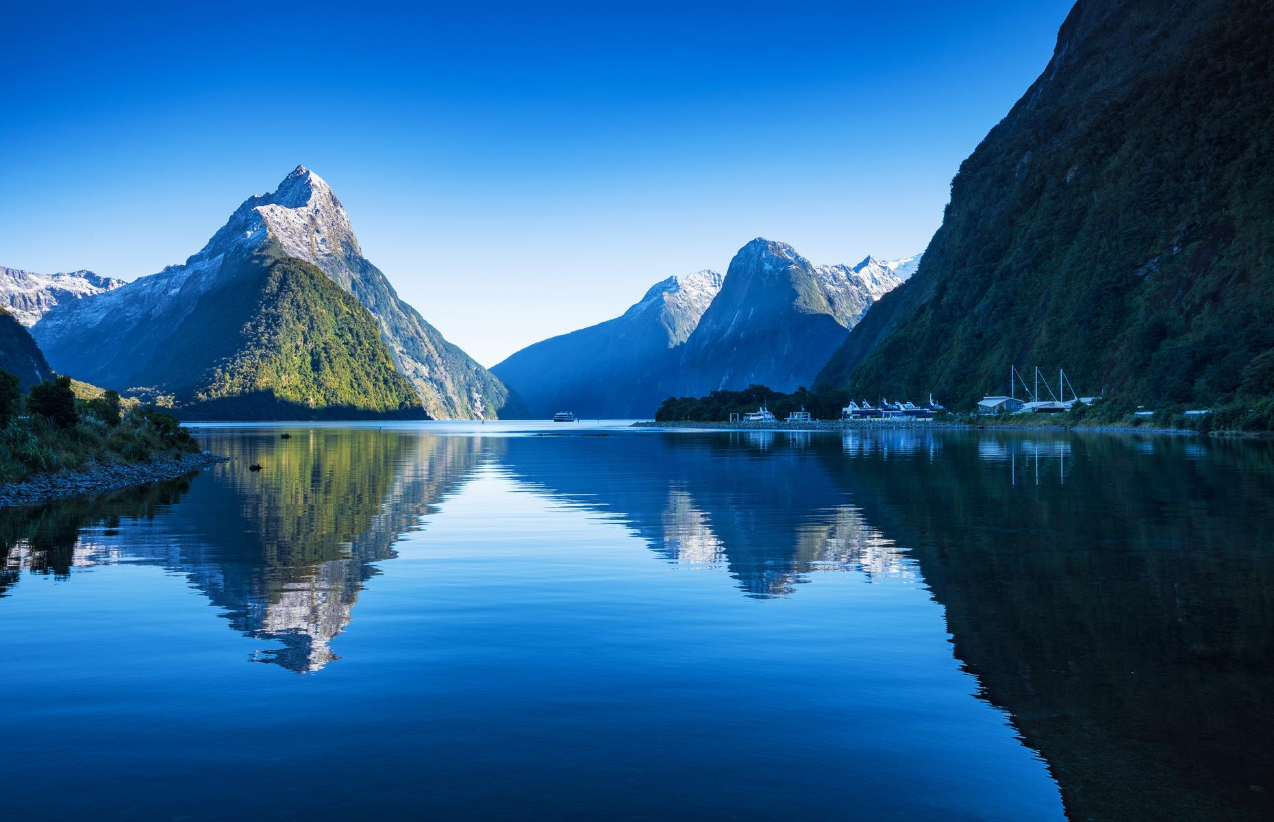 """Slide 9 of 51: With soaring snow-capped mountains, dazzling waters and lush rainforest, the majesty ofNew Zealand's Fiordland National Park gives Norway some stiff competition. The jewel in this magical region in the island's southwest corner isMilford Sound, one of the 14 fiords that fringe the park, measuring up to 1,321 feet (400m) deep. Home to craggypeaks, tumbling cascades and forest-cladcliffs, Rudyard Kipling wasonto something when he called Milford the """"eighth wonder of the world"""". Exploremore of the last unspoiled places on Earth here."""
