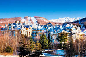 a castle like building with a mountain in the background: (Photo courtesy of Le Westin Tremblant)