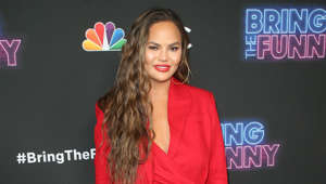 "Chrissy Teigen holding a sign: The model doesn't hide her hatred of the President of the United States and often criticises his actions and words on her social media.  In 2017, Teigen she said: ""I've actually been a big Donald Trump hater (for a long time). I've been trolling him for about five to seven years now. I've been doing this forever, and I take pride in that. I can't believe that somebody could actually do this all day everyday and be president."""