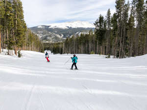 a group of people riding skis down a snow covered slope: (Photo by Summer Hull/The Points Guy)