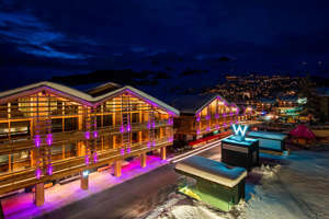 a building lit up at night: (Photo courtesy of the W Verbier)