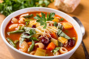 a bowl of food on a table: When the weather gets chilly there is nothing like a nice soup to warm you up! I compiled a list of the best soup recipes for you to make this winter.  All of these easy soup recipes are being added to the rotation of soups that I make for my family.I love soups! Wintertime in my house means lots of soups for lunch and supper. Here are some of the best and easy soup recipes that I have found.Soups freeze really well so anytime I come across a easy soup recipe that we love I make double and freeze it.The less ingredients a recipe has the cheaper it usually ends up being- unless the one ingredient it pretty expensive.Whether you are looking for recipes with few ingredients, cheap soup recipes, healthy soup recipes, or the best soup recipes for dinner you can find it in this list!