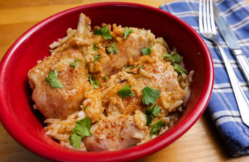 a bowl of food on a plate: Recipe of the Day: Chicken Paprikash With Rice