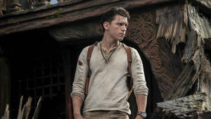 Tom Holland standing in front of a building: Tom Holland in the Uncharted movie