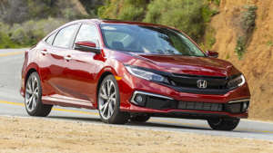 a car parked on the side of a road: 2020 Honda Civic Sedan