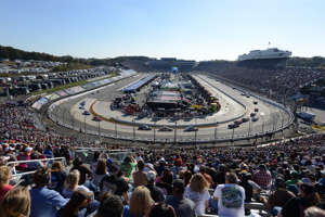 a large crowd of people: Martinsville Speedway, the oldest track on the NASCAR Cup Series circuit, hosts this weekend's playoff race. We take a look back at some of the sport's top moments at the .526-mile facility.