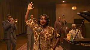 "a group of people standing in a room: ""Ma Rainey's Black Bottom,"" starring Viola Davis as the famed 1920s blues singer, kicks off a busy holiday season of streaming and video-on-demand movies when it debuts Dec. 18 on Netflix. Here are exclusive looks at all the movies you'll want to watch at home in November and December."