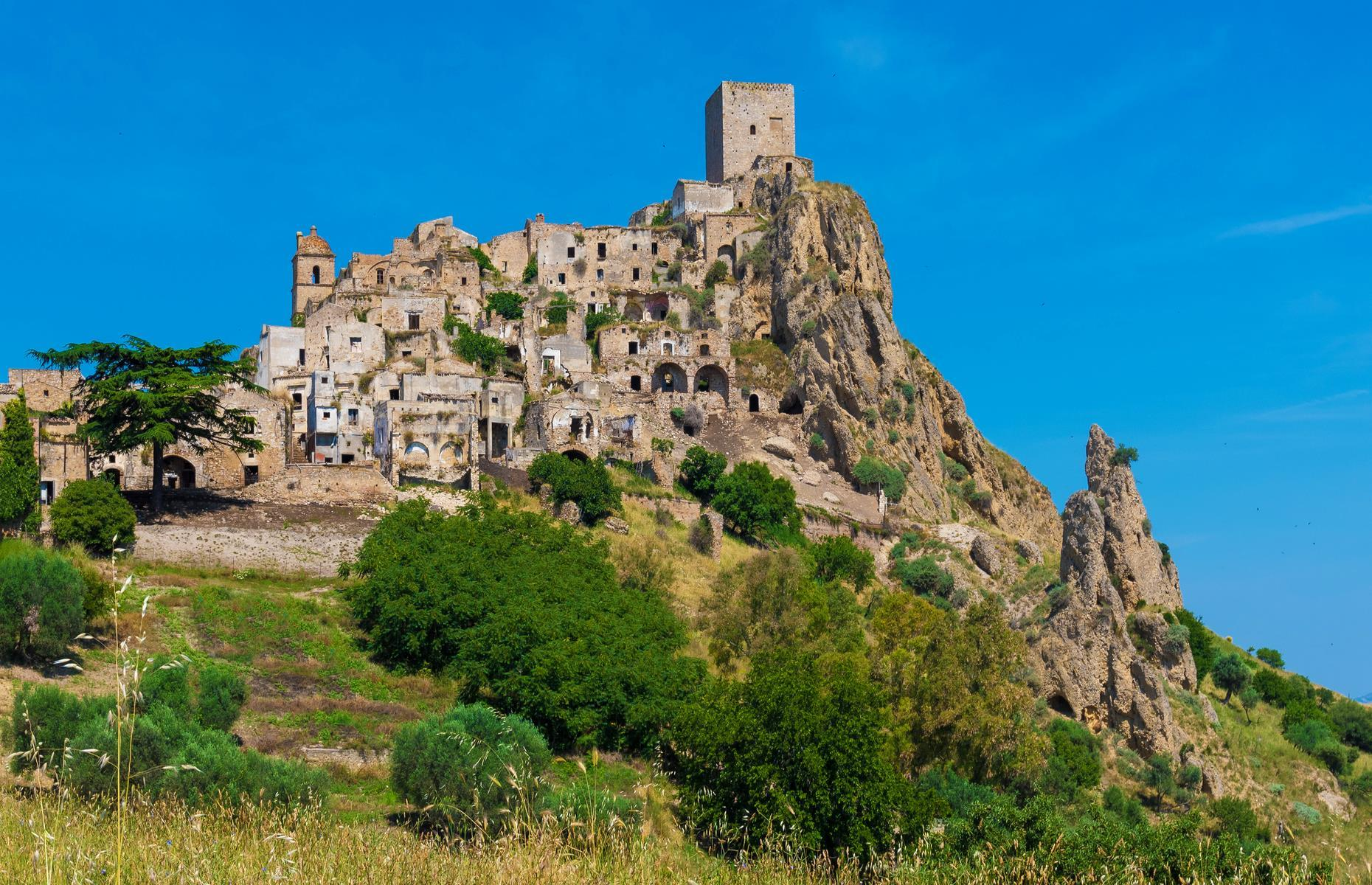 Slide 34 of 41: Cascading over a hilltop in Italy's Matera province, Craco is quite a sight. It seems almost to blend with its surroundings, its windowless buildings the same color as its craggy perch. But though it looks at one with the wilderness now, Mother Nature hasn't been kind to Craco over the centuries. See more perilous places around the world here.