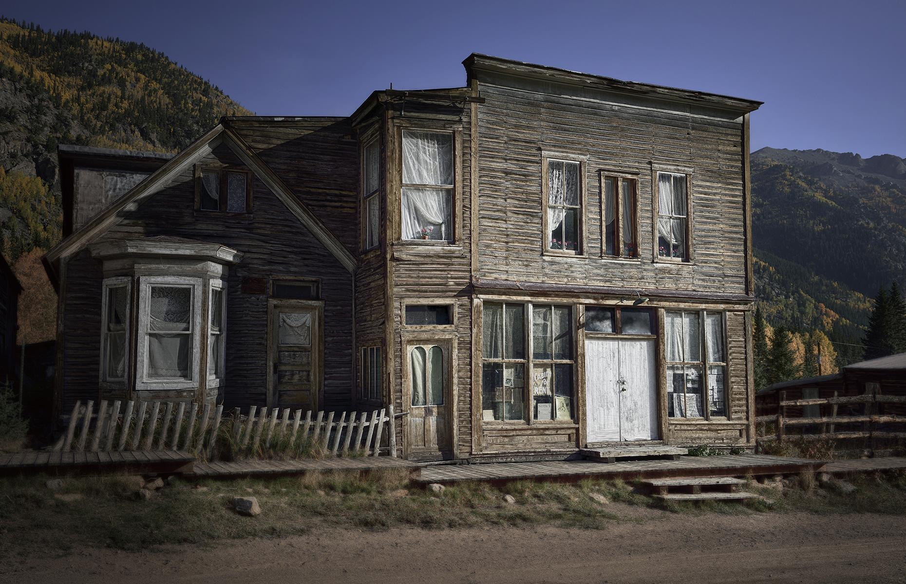 Slide 12 of 41: Especially after nightfall, St Elmo's string of wood-clad buildings wouldn't look out of place in a horror film. The mining town sprang up in the 1880s with nearly 2,000 residents living off the bounty of gold and silver in the region. However, in the 1920s, the halting of a key railroad service meant that St Elmo's inhabitants up and left, riding the last train out of town and never looking back.