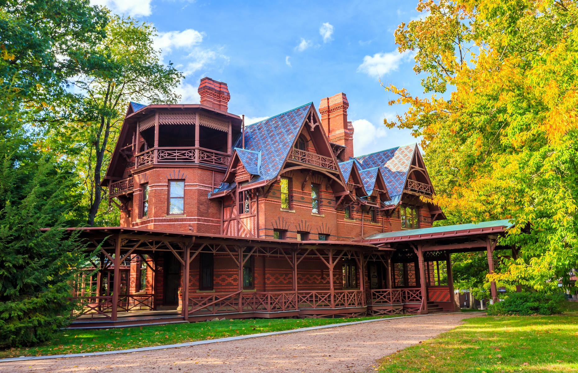 Slide 31 of 31: This house in Hartford had a famous owner, the iconic American writer Mark Twain, akaSamuel Langhorne Clemons, who had it built in the late 1800s. The 11,500-square-foot (1,068sqm) American High Gothic-style house was designed by architect Edward Tuckerman Potter and ended up being an expensive project wrought with delays. That didn't dampen Twain's creativity though, as while living herehe wrote the classics The Adventures of Tom Sawyer and Adventures of Huckleberry Finn, among others. Discover more of America's most important landmarks