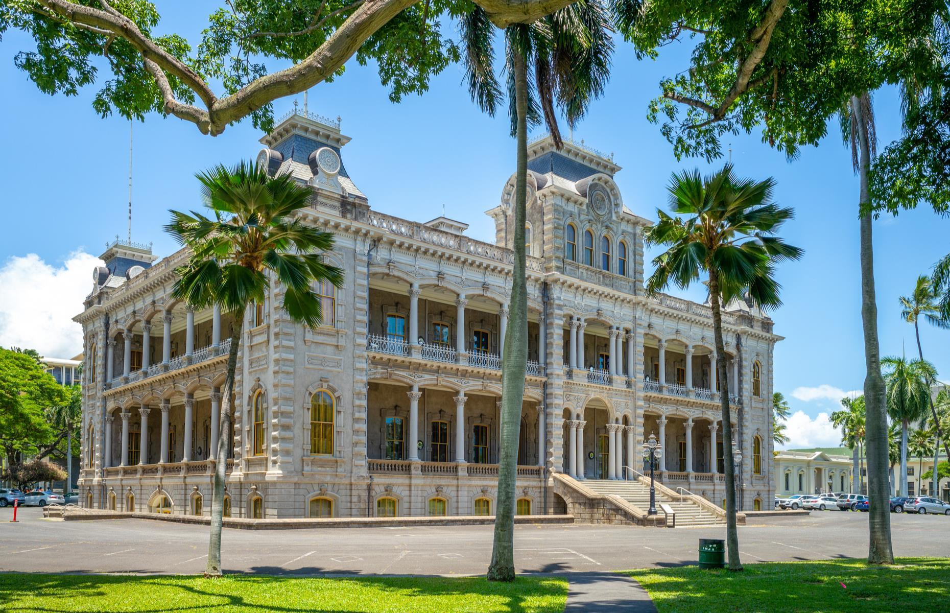 Slide 13 of 31: In the late 1800s, Honolulu's Iolani Palace was the official home of the Hawaiian monarchy. However, its life of royalty didn't last long as a coup saw the royal family overthrown in 1891. As the islands were transferred into a US state, Iolani Palace went from being a royal residence to functioning as a capitol building to, finally, disrepair. In 1978, after stunning renovations, the first two floors were opened to the public in all of their original grandeur. Discover more American castles you probably didn't know existed.