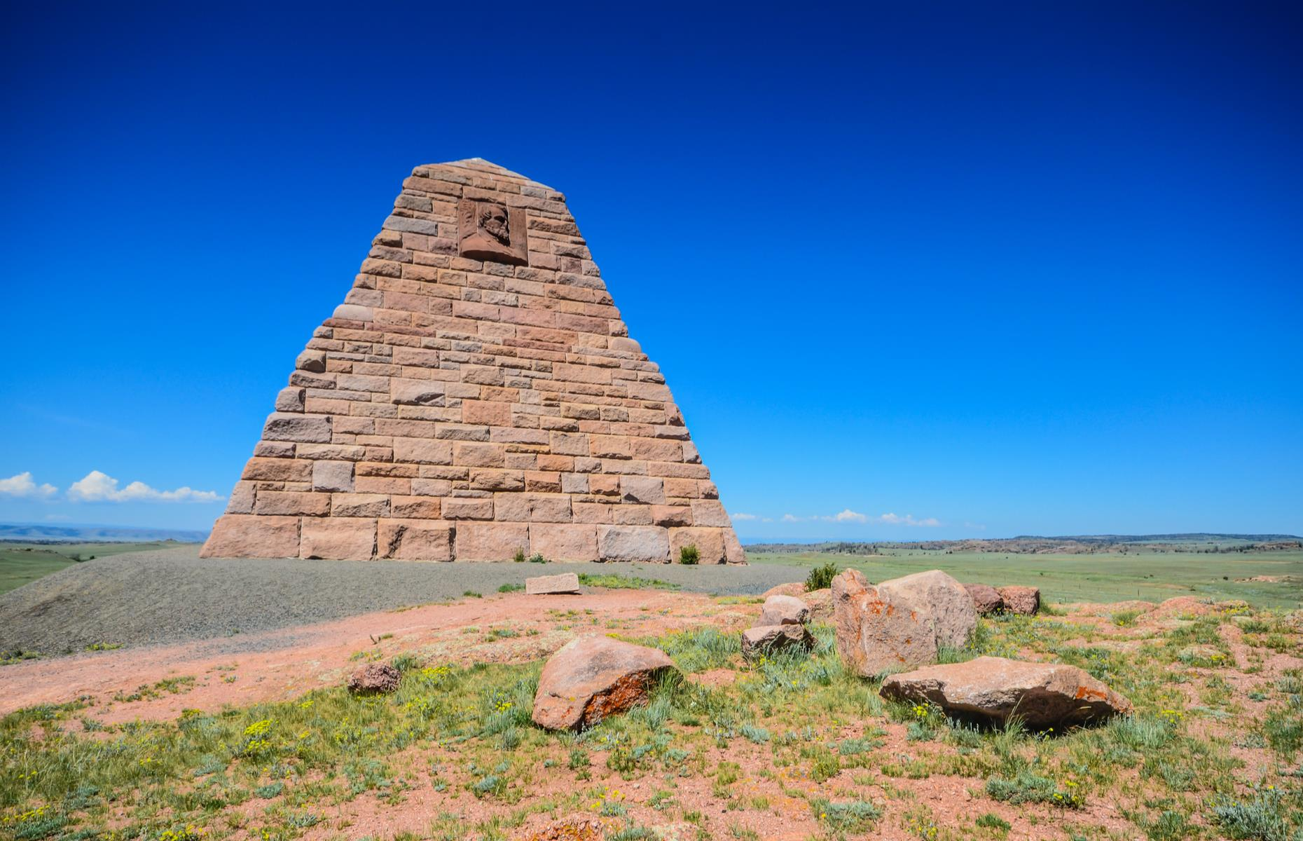 Slide 28 of 31: While the Ames Monument may look like something from ancient Egypt, this four-sided, granite pyramid was actually constructed in 1881 by architect Henry Hobson Richardson. Located east of Laramie, it once marked the highest point on the Union Pacific Railroad, before the tracks were moved in 1901. The monument was erected to honor brothers Oliver and Oakes Ames, important leaders of the railroad's construction. The pyramid's base is 60-feet (18m) wide and it's 60-feet tall.