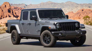 a car parked in front of a mountain: Jeep Gladiator Willys Front