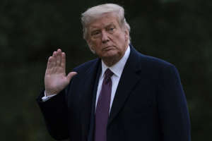 Donald Trump wearing a suit and tie: We are reminded, again and again, of just how bad a second term would have been, and will be if Trump runs and wins again. (Associated Press)