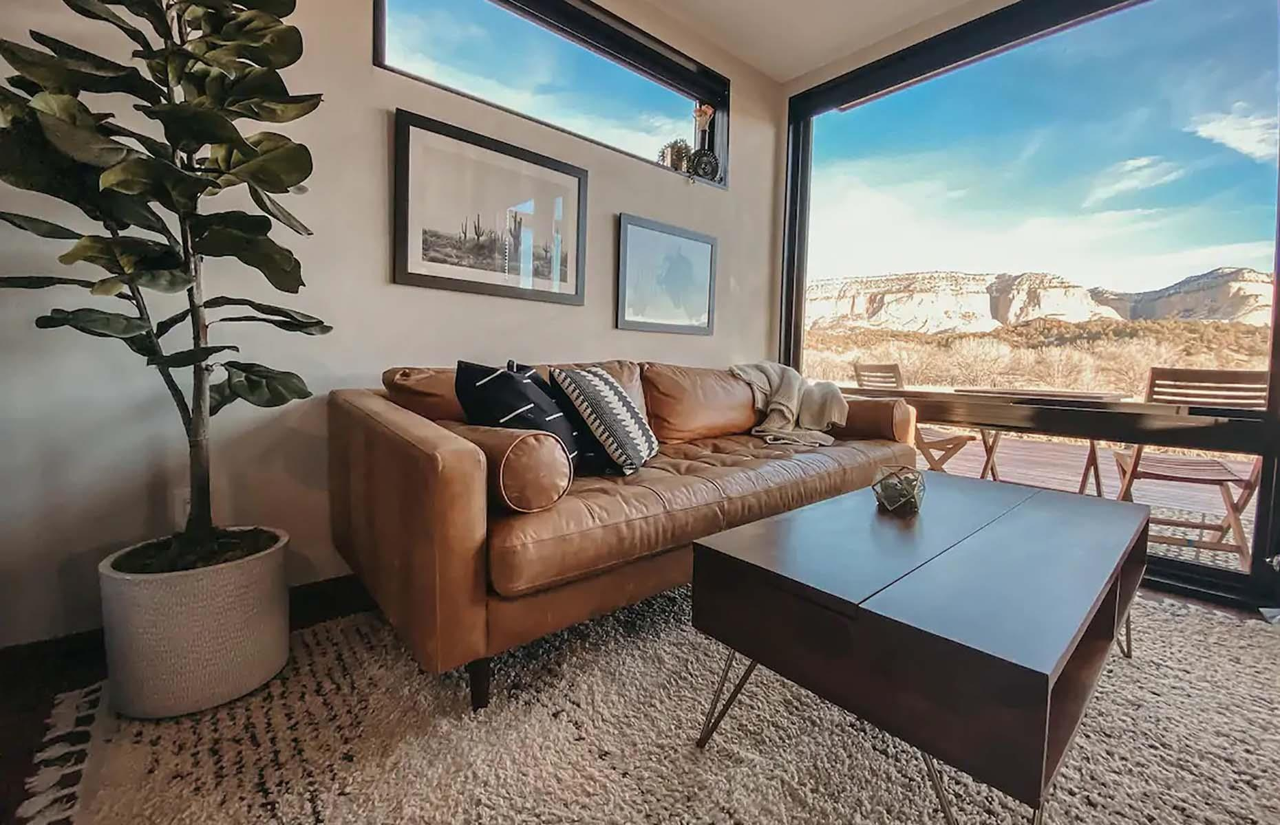 Slide 25 of 31: An incredibly stylish space with an equally impressive view to match, this tiny house in Utah is unforgettable. Accessible from the Scenic Highway 89, the home's picture windows open up to scenery of the soaring Elkhart Cliffs. The studio features a huge walk-in shower, fully-equipped kitchen and a queen-sized bed.