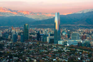 a view of a city with a mountain in the background: Photo of Santiago, Chile (Photo by Jose Luis Stephens / Getty Images)