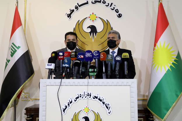 Slide 2 of 144: ERBIL, IRAQ - NOVEMBER 17: Iraqi Kurdish Regional Government (KRG) Interior Minister Rebar Ahmed Khalid (R) and Iraqi National Security Advisor Qasim al-Araji (L) speak during a press conference after a meeting on the implementation of the Erbil-Baghdad deal on normalization of the situation in Sinjar following Sinjar Agreement in Erbil, Iraq on November 17, 2020. According to the agreement, the presence of the PKK (listed as a terrorist organization by Turkey, the U.S. and the EU) and other illegal groups in Sinjar and surrounding areas will be ended. (Photo by Yunus Keles/Anadolu Agency via Getty Images)