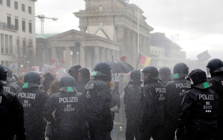 Police fire water cannon at anti-lockdown protesters in Germany