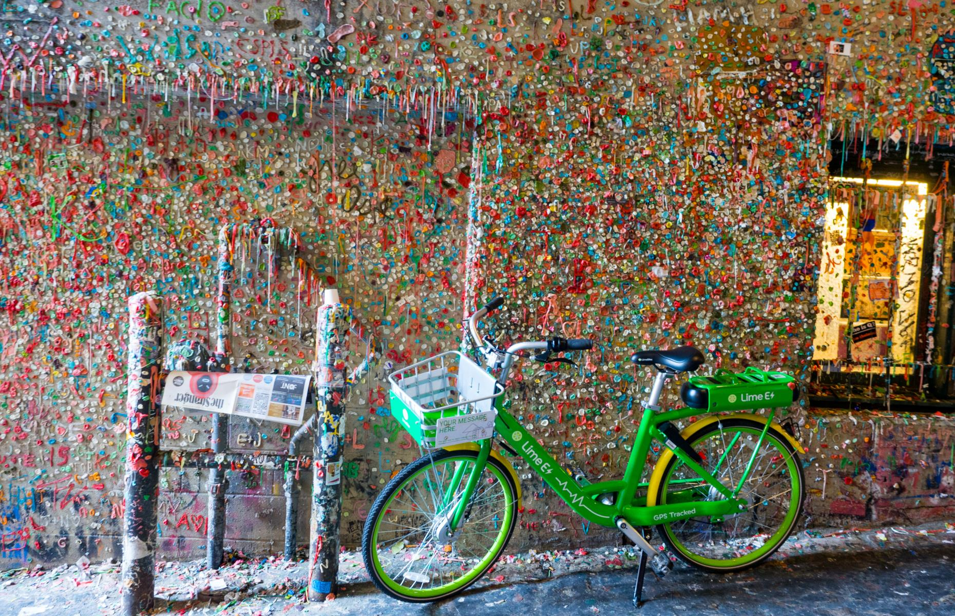Slide 25 of 31: The chewing gum wall in Seattle's Pike Place Market is a funny sight. A splash of different colored gum covers the wall, with some pieces stretched or shaped into messages. Pictures and mementos are also glued up. It all began in the 1990s, with theater-goers sticking their gum to the wall while waiting for shows. In 2015 the market management tried to clear it up, steaming a total of 2,350 lbs off the wall, but the very next week people were right back at it.