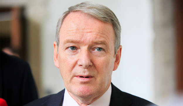 Brian Stanley wearing a suit and tie looking at the camera: The Brian Stanley embarrassment has opened a Pandora's box for Sinn Féin. Pic: Gareth Chaney/Collins