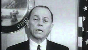 a man standing in front of a mirror posing for the camera: Please listen to the Cincinnati Juvenile Court, or god help us all. My thanks to writer Steven Rosen for identifying this upstanding citizen as Judge Benjamin Schwartz. This was filmed on August 28, 1964.