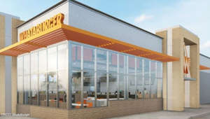a large brick building: What happened to Whataburger?