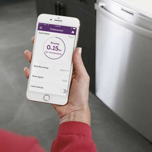 a hand holding a box: ge dishwasher app