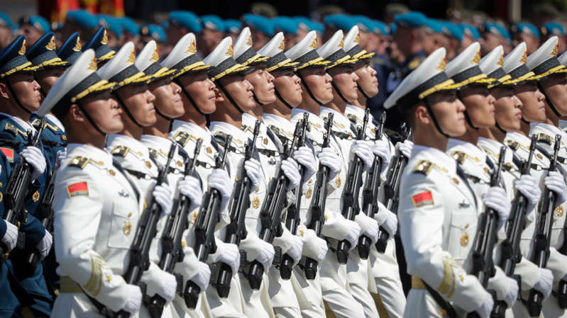 a group of men in uniform: Australian ministers and officials have expressed concern about China's growing power in the Asia Pacific.