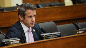 Adam Kinzinger in a suit sitting at a desk: Kinzinger says he is 'in total peace' after impeachment vote