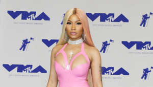 "Nicki Minaj holding a sign posing for the camera: Lil Kim has long claimed that the 'Anaconda' singer stole her style. The two have been feuding for years ever since Minaj released a promotional photo in a similar style to Lil Kim's.  During an interview on Hot 97 FM, Minaj spoke about her beef with Lil Kim, saying: ""You're going to go down in history now as a sore loser, as opposed to going down in history as the Queen… Don't play with me."""
