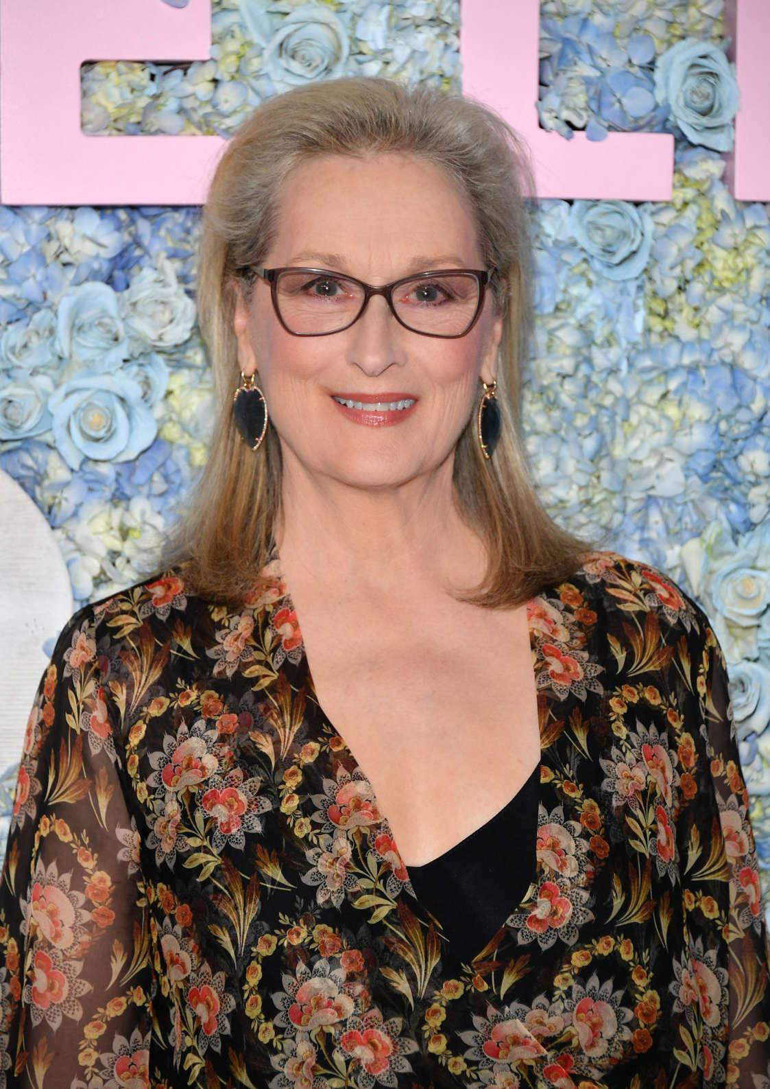 Meryl Streep in glasses looking at the camera