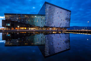 Harpa over a body of water: You can visit Reykjavik's Harpa Concert Hall when you stay at the new Edition in town. (Photo by Nicram Sabod/Shutterstock)