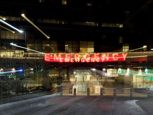 a store front at night:  South Health Campus, one of several hospitals in Calgary dealing with COVID-19 outbreaks.