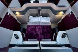 a close up of a chair: Qatar Airways' Qsuites business class award space is plentiful throughout 2021. (Photo by Zach Griff/The Points Guy)