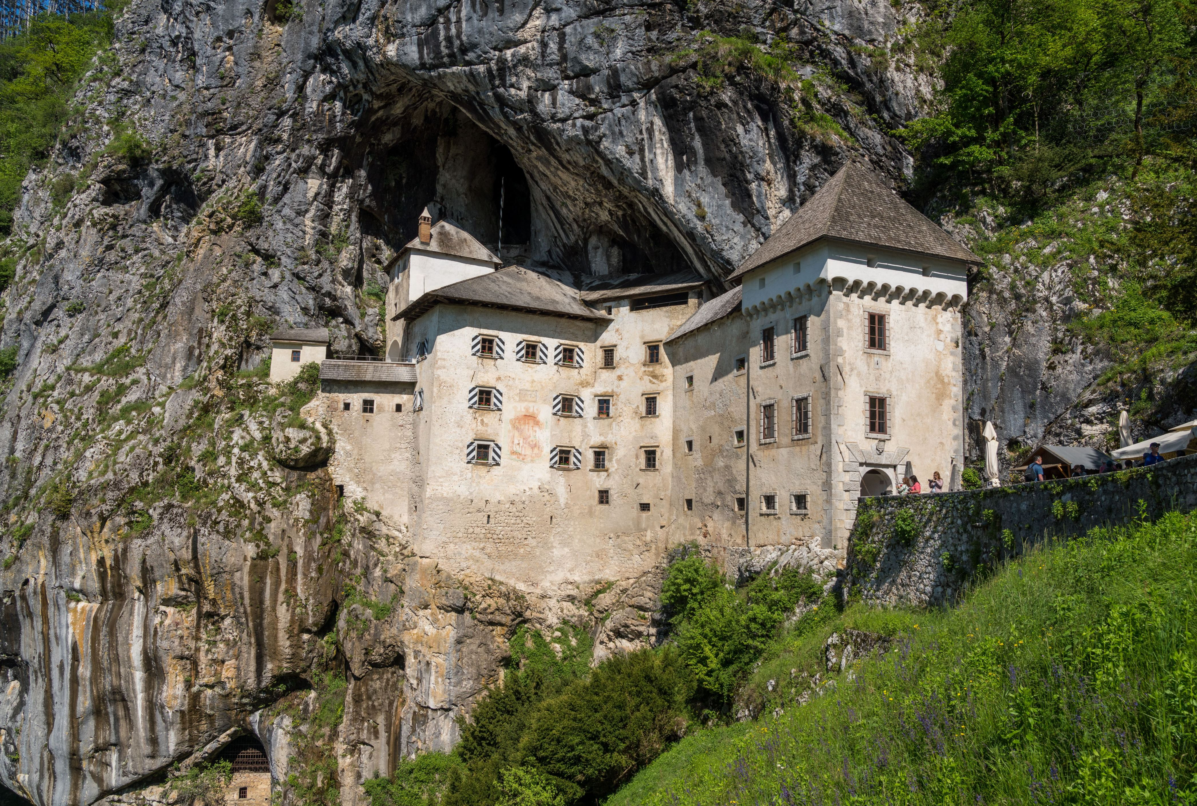 Slide 21 of 52: Built into a mountainside in Predjama, Slovenia, the castle guards a network of secret tunnels — and a colony of bats.