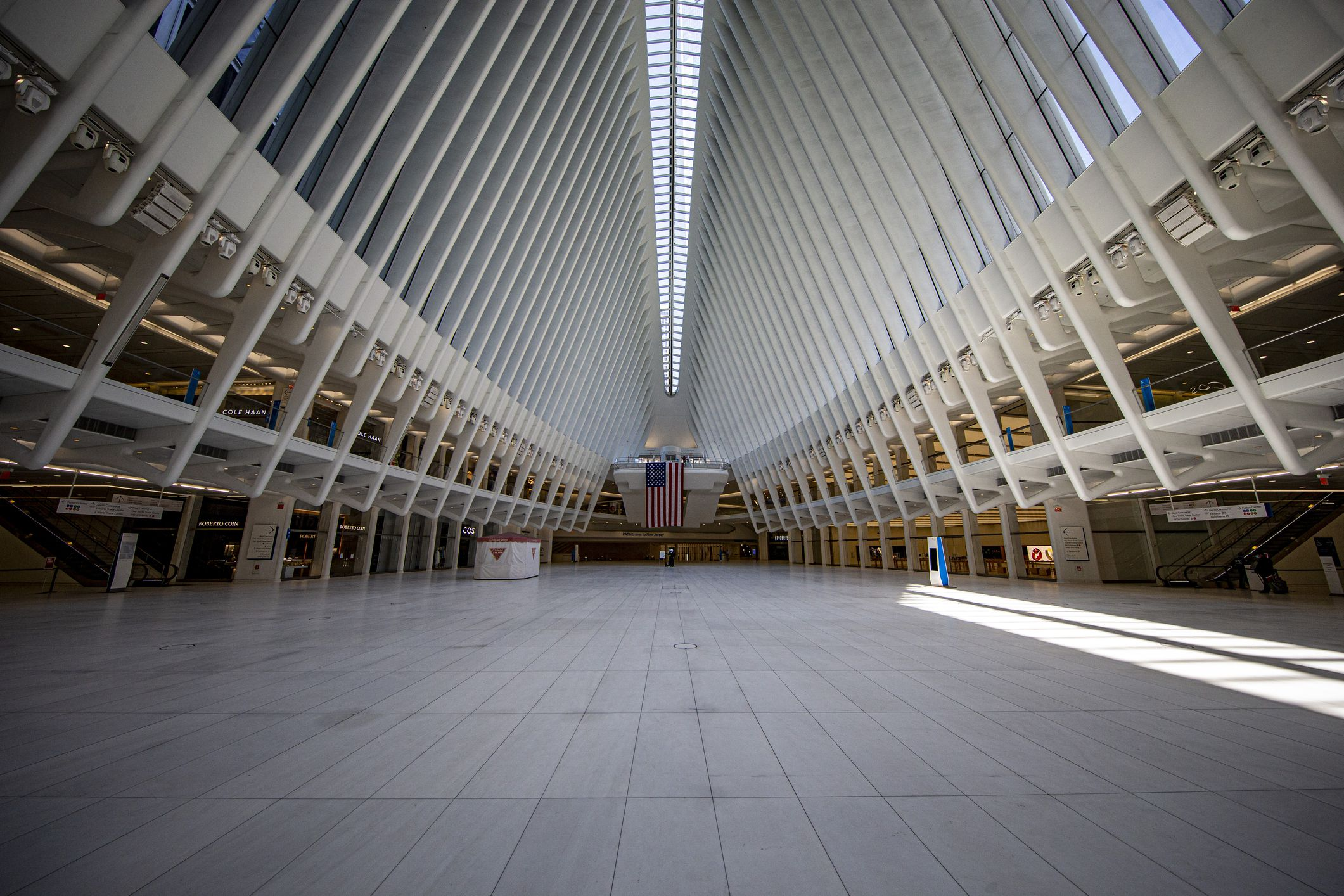 Slide 34 of 52: The transportation hub, which houses 12 New York City subway lines and the N.J World Trade Center PATH station, was designed as a memorial to the 9/11 terrorist attacks. It also houses many high-end retail shops.