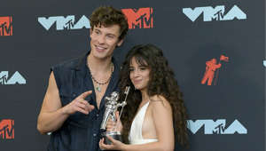 Shawn Mendes, Christin Hinojosa are posing for a picture