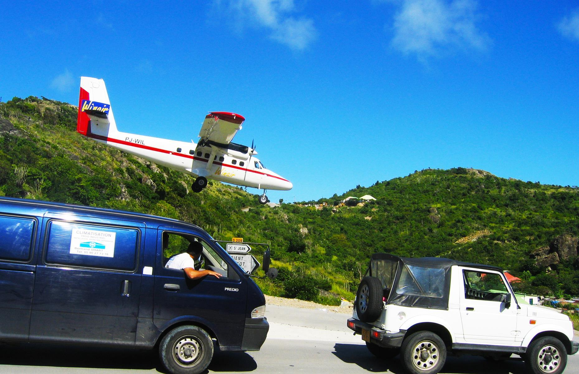 Slide 30 of 44: Only light aircraft carrying up to 20 passengers can land at Gustaf III airport (also known as Saint Barthélemy Airport) on the gorgeous Caribbean island of St Barts, and for good reason. The perilous approach involves swooping down a steep hill, just feet away from traffic and vegetation, before touching down onto a tiny 2,132-foot (650m) runway.