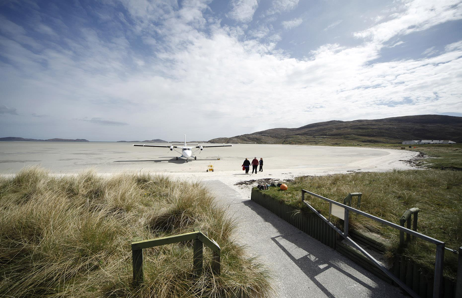 Slide 9 of 44: It may be remote but, according to HIAL, in a normal year around 10,000 passengers pass through Barra airport. The beach is also popular with cockle collectors who are warned to steer clear of the landing strips. As well as a terminal building with car hire and a café, Barra has its own fire crew, although they're more often called out to save stranded seals or dolphins than anything linked to the airport.