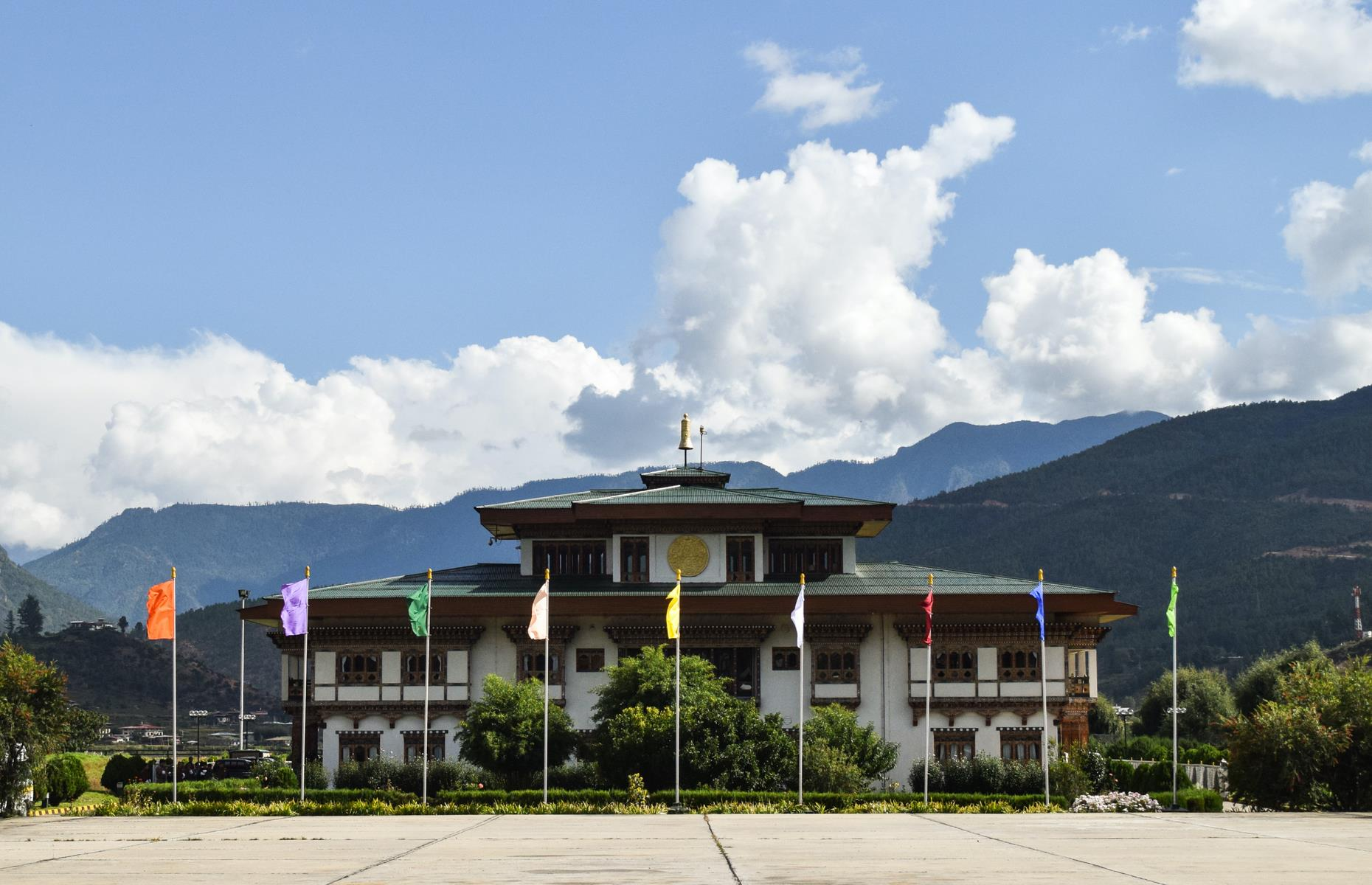 Slide 18 of 44: The treacherous landing, which involves sweeping within feet of the roofs of local houses, means flights are only permitted in daylight. The terminal building is designed in keeping with Bhutan's traditional architecture and although facilities are minimal, it has a comfortable waiting room adorned with paintings of Bhutan kings past and present.