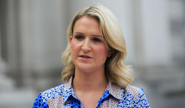 a woman wearing a blue shirt: Minister for Justice Helen McEntee praised the work of Gardai over the course of the last 12 months, this weekend marking 12 months since the first COVID case was reported in the Republic of Ireland. Pic: Gareth Chaney/Collins