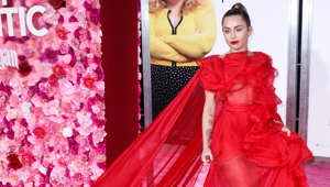 "Miley Cyrus wearing a dress: At another premiere to support her ex-husband, Cyrus looked next-level glamorous in a Maison Valentino crimson tulle and matching red lipstick. Pushing her hair back into a sleek high ponytail, the singer made sure all our attention was on the gown. She walked the red carpet alone, representing Hemsworth, who was absent due to health issues. Cyrus joked about the reason she was really there: ""I already had the dress. Everyone thinks I'm here for Liam, but I'm really here for Maison Valentino."""