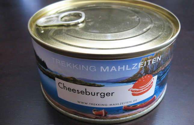 Slide 5 of 29: You can thank Swiss company Katadyn Group for making cheeseburgerin a cana reality. The company specialises in food for outdoor sports andto cook this meal, you mustsimmer an unopened can in boiling water. Take a look at these surprising fast food facts