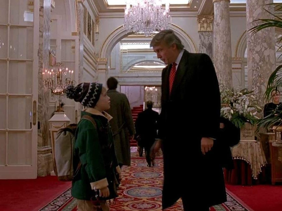 Slide 24 of 36: Once McCallister finally makes it to the hotel, he explores the extravagant lobby.It's decorated for the holiday season, and pots are filled with poinsettias.Using a fake voice, he calls to make a reservation for a suite.