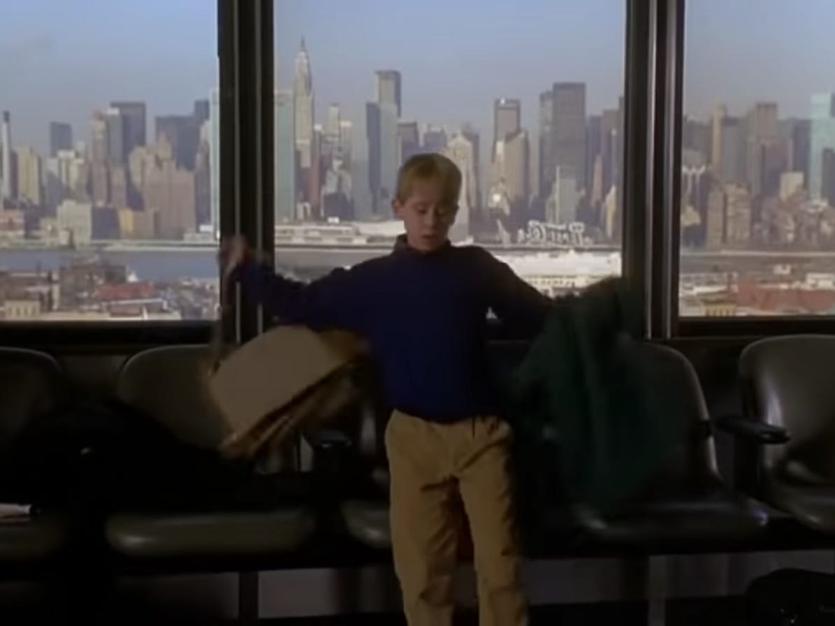 Slide 5 of 36: After mistaking a man in a tan jacket as his father, McCallister arrives in New York City with the cityscape on full display in the background.Initially feeling defeated, McCallister quickly realizes that a solo trip to New York City could be a fun adventure.