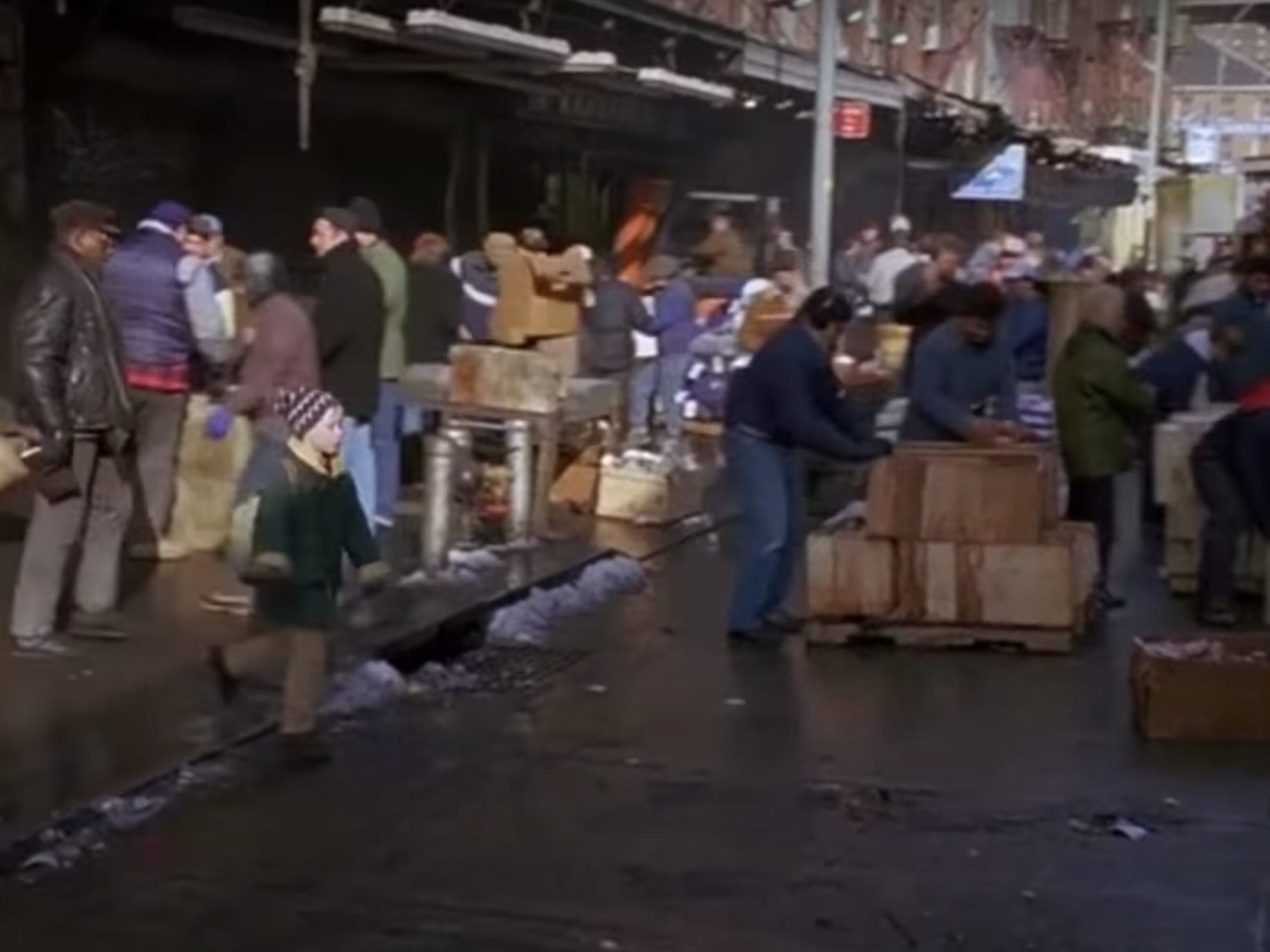 Slide 18 of 36: This is Harry and Marv's entrance to the movie. The two have escaped from prison and are spotted in the back of a fish delivery truck.They've traveled to New York City to steal money.The fish mark is portrayed as bustling place in the movie.