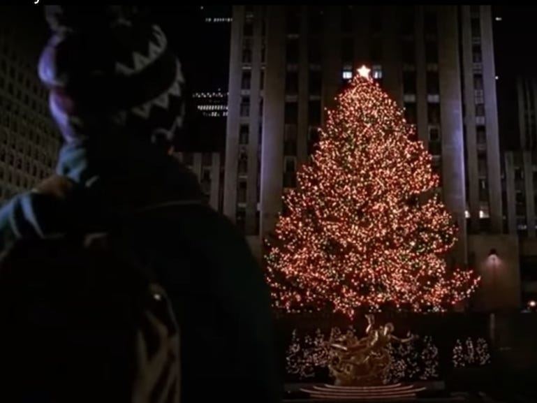 Slide 34 of 36: In the plaza, McCallister reunites with his mother, who flew to New York to search for her son.In the movie, the plaza is completely empty.