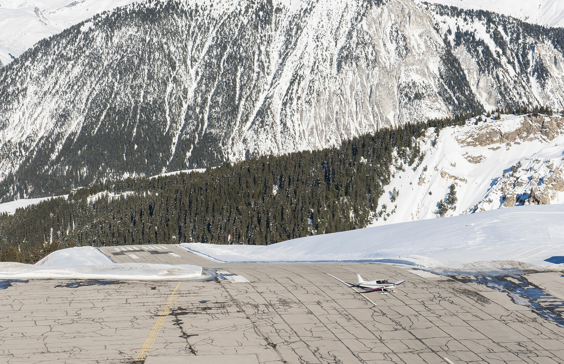 Slide 3 of 31: The runway is sloped upwards to a gradient of 18.66%–the highest gradient in the world no less– and, owing to its proximity to the ski resort and passing skiers, it's probably just as scary being on the ground as in the plane.