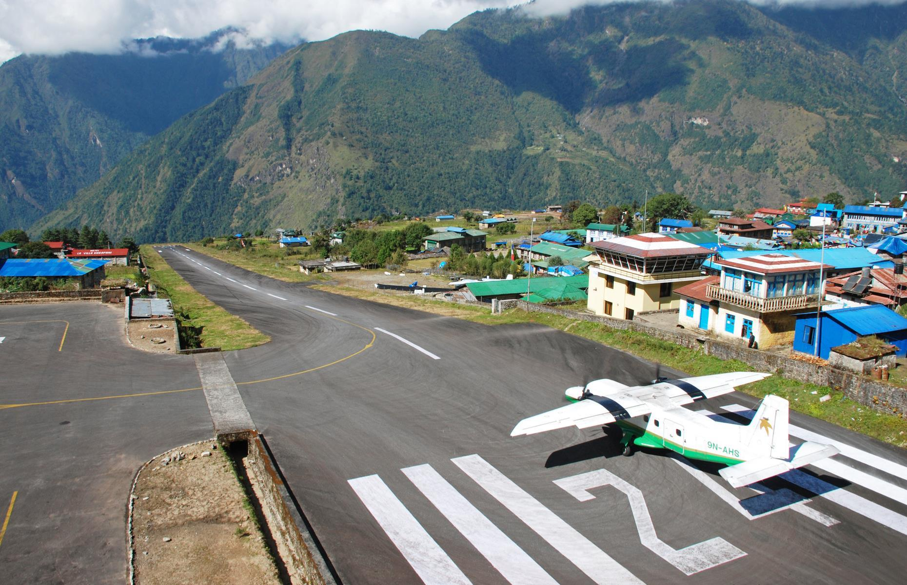 Slide 31 of 31: Needless to say, it's not a journey for the faint-hearted, with a mountain at one end of the runway and a 1,000-foot (304m) sheer drop at the other. Taking off isn't any less hairy: the runway is only 1,729 feet (527m) long. Sometimes, this unique airport has to close briefly during the morning due to strong southwest winds which whip around the area. Now take a look at the world's best airports you've never heard of