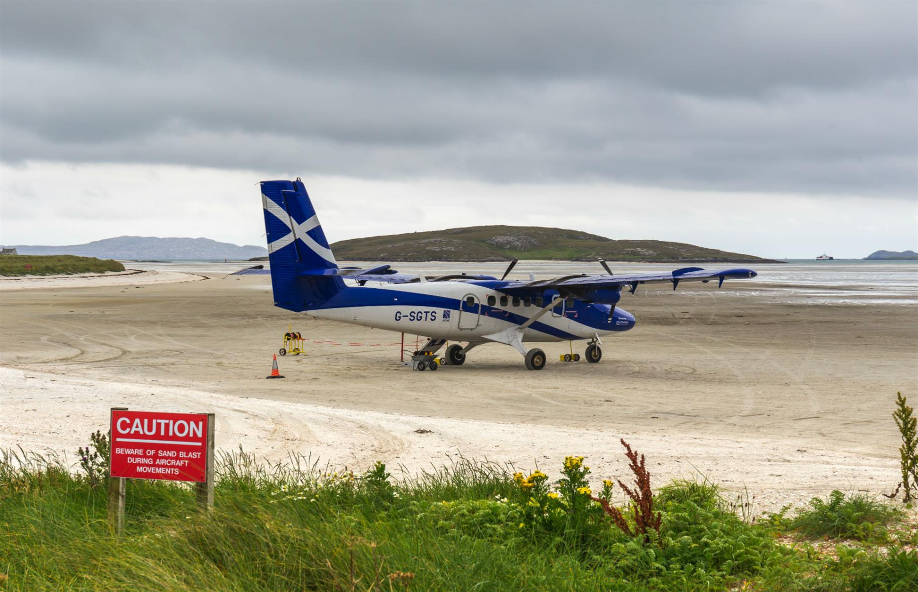 Slide 6 of 31: The airport on the tiny island of Barra in the Outer Hebrides, off the west coast of Scotland, is the only place in the world where scheduled flights land on the beach. Here are more of the most remarkable tiny airports in the world